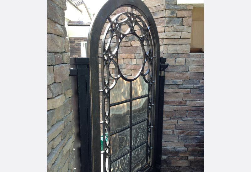 Angels ornamental iron gallery orange county ca ornamental angels fabricated this custom wrought iron door with black onyx stone inserts in villa park ca to achieve a stunning one of a kind iron door planetlyrics Choice Image