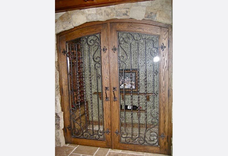 This Wrought Iron Wine Cellar Door In Newport Beach Ca Once Used To Be A Plain Wooden Angels Ornamental Helped Our Clients Transform It Into